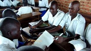 Ugandan primary school students studying in their classroom