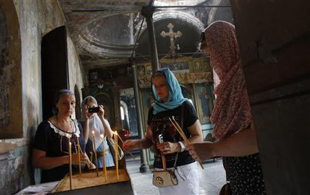 Russian Orthodox worshippers light candles at St Elijah's Church in Istanbul