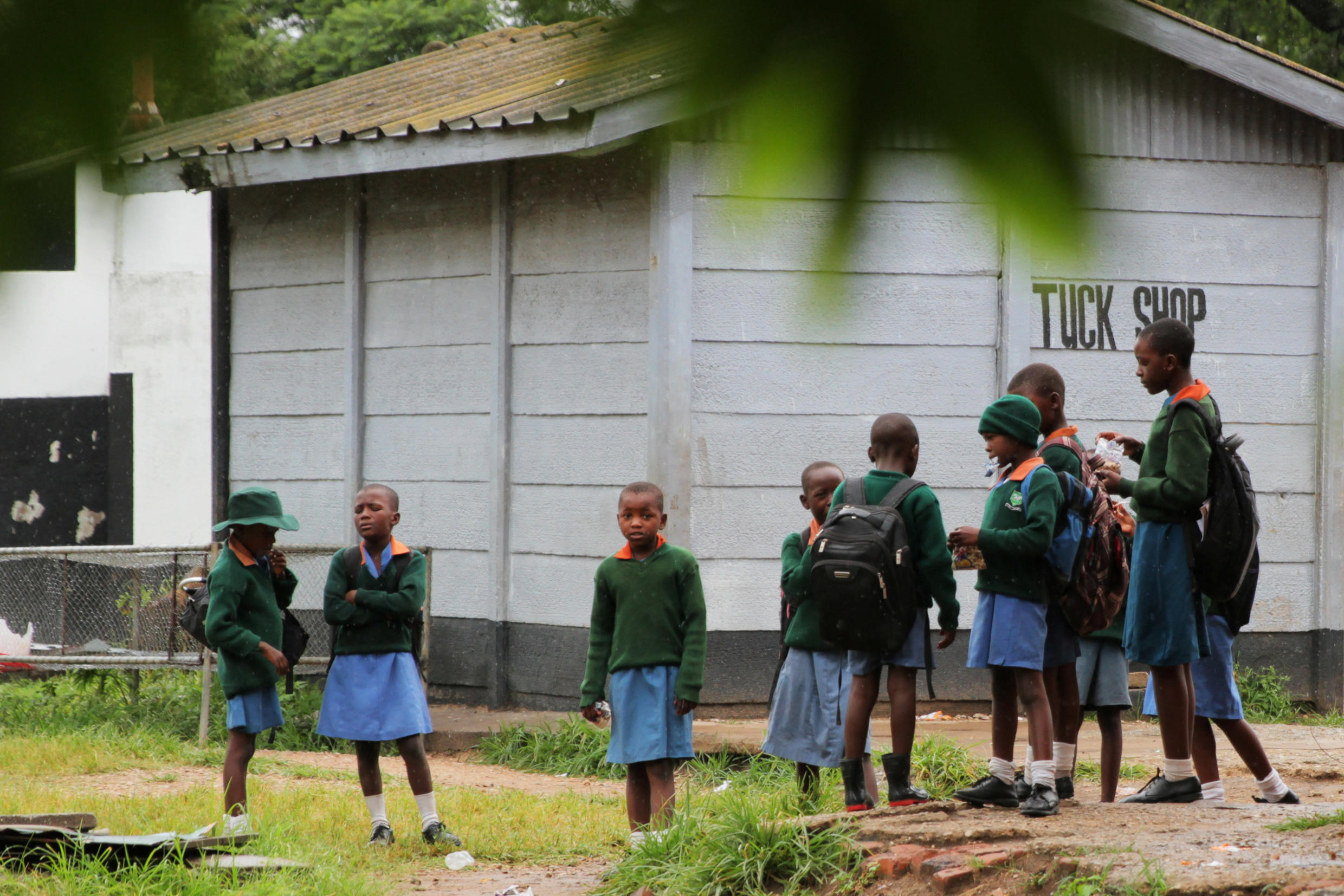 Pupils stand outside classrooms at a government school in the capital city of Harare, Zimbabwe, February 5, 2019