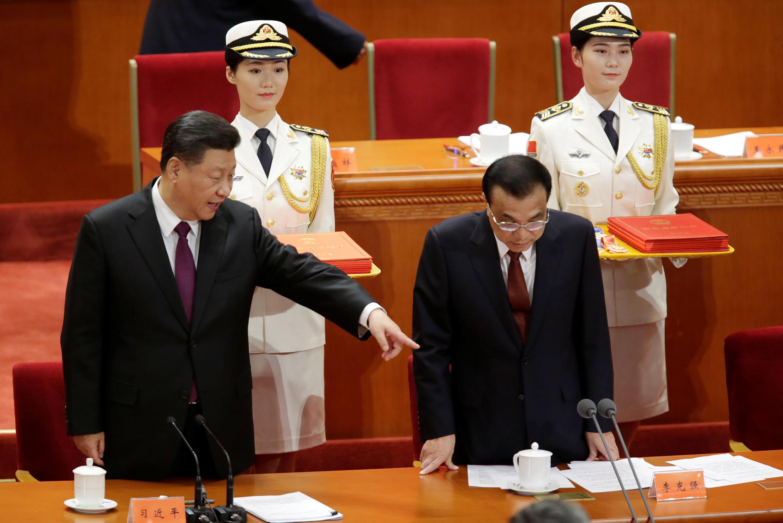 Chủ tịch Trung Quốc Tập Cận Bình (T) và thủ tướng Lý Khắc Cường tại Đại sảnh đường Nhân Dân ở Bắc Kinh ngày 18/12/2018.
