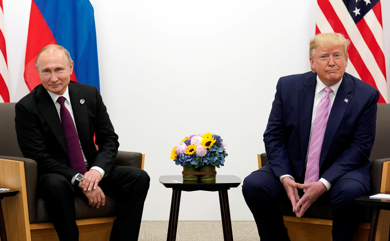Владимир Путин и Дональд Трамп во время саммита G20 в Осаке, 28 июня 2019.