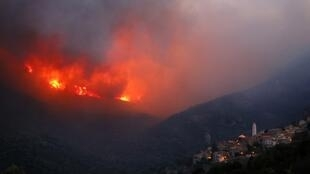 Fire engulfs the hills close to the village of Palasca on the French Mediterranean Island of Corsica on 22 October, 2017.