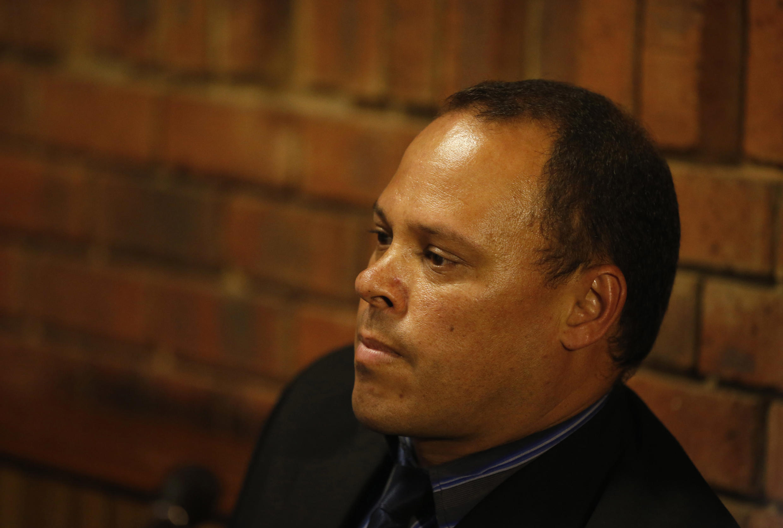 Trưởng nhóm điều tra trong vu án Oscar Pistorius,  Hilton Botha, ra trước toà án, ngày   21/02/2013.
