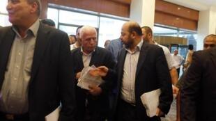 La delegación plestina presente en el  Cairo para negociar con Israel, el 13 de agosto del 2014. REUTERS/Asmaa Waguih.
