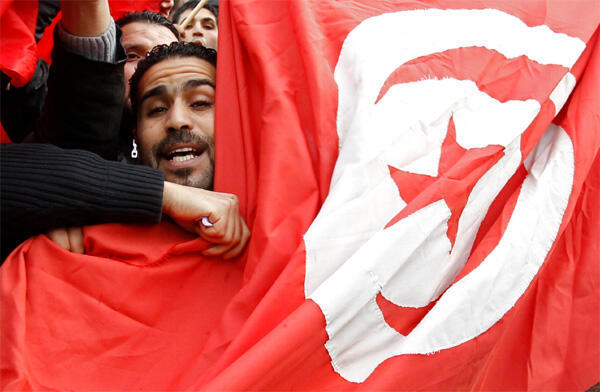 Tunisians living in Belgium shout slogans during a protest against Tunisian President Ben Ali in Brussels