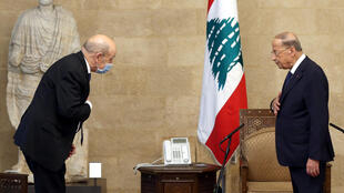 "Visiting French Foreign Minister Jean-Yves Le Drian is received by Lebanese President Michel Aoun on a two-day visit in which he called for a ""surge of effort"" by Lebanon's leaders to spare the country ""collective suicide"""