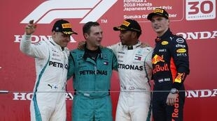 Mercedes' Lewis Hamilton celebrates winning the race with second placed Valtteri Bottas and third placed Red Bull's Max Verstappen.