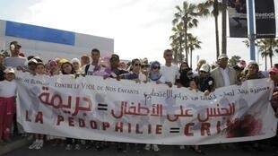 Women and children take part in a march against child abuse, Casablanca, 5 May
