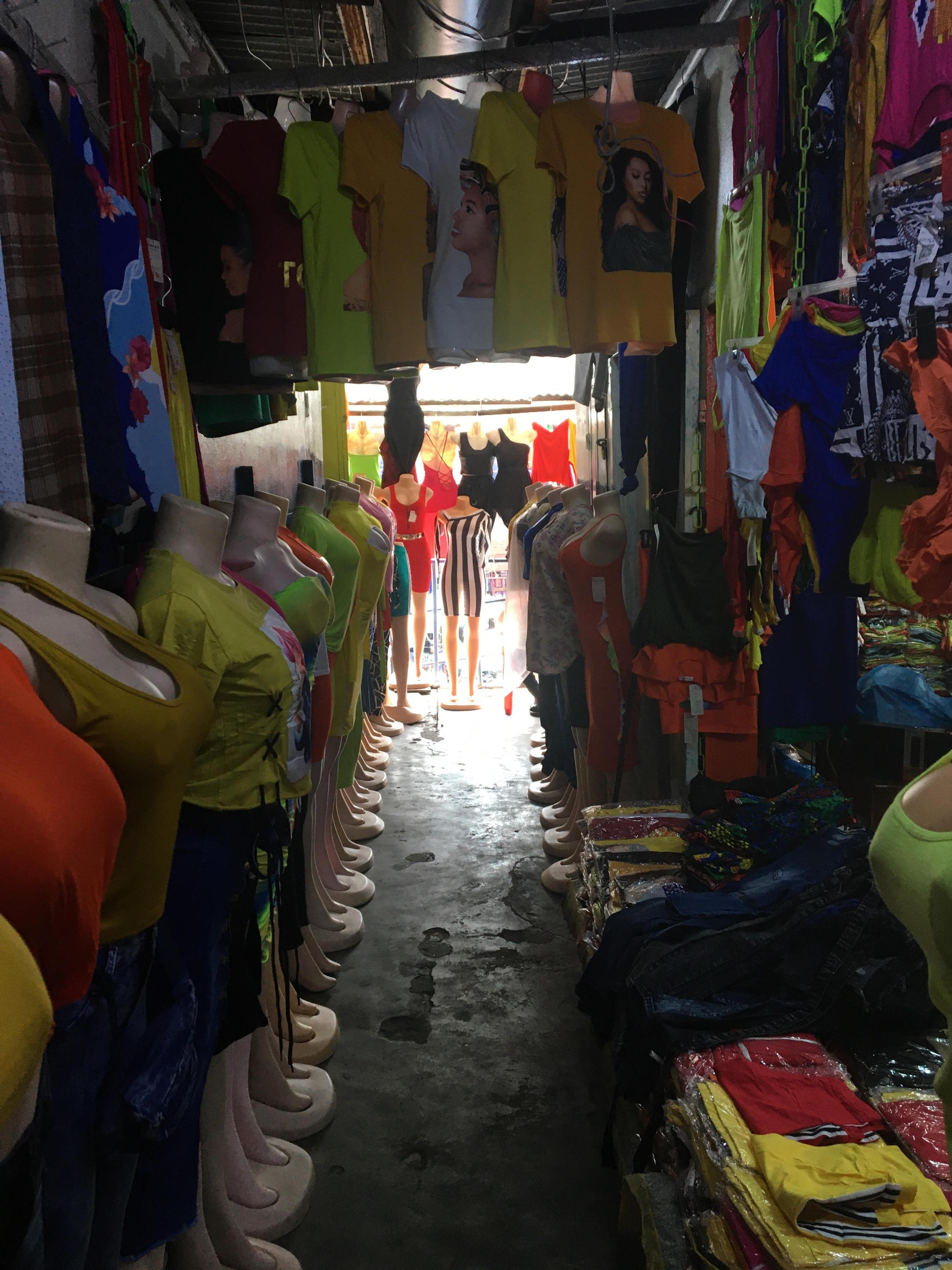 No customers buying clothes at the China Market building.