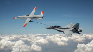 This Boeing handout photo obtained June 7, 2021 shows the Boeing MQ-25 T1 drone as it transfers fuel to a US Navy F/A-18 Super Hornet three days earlier
