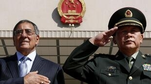 U.S. Secretary of Defense Leon Panetta stands during the national anthem next to China's Defense Minister Liang Guanglie in Beijing, 18 September, 2012