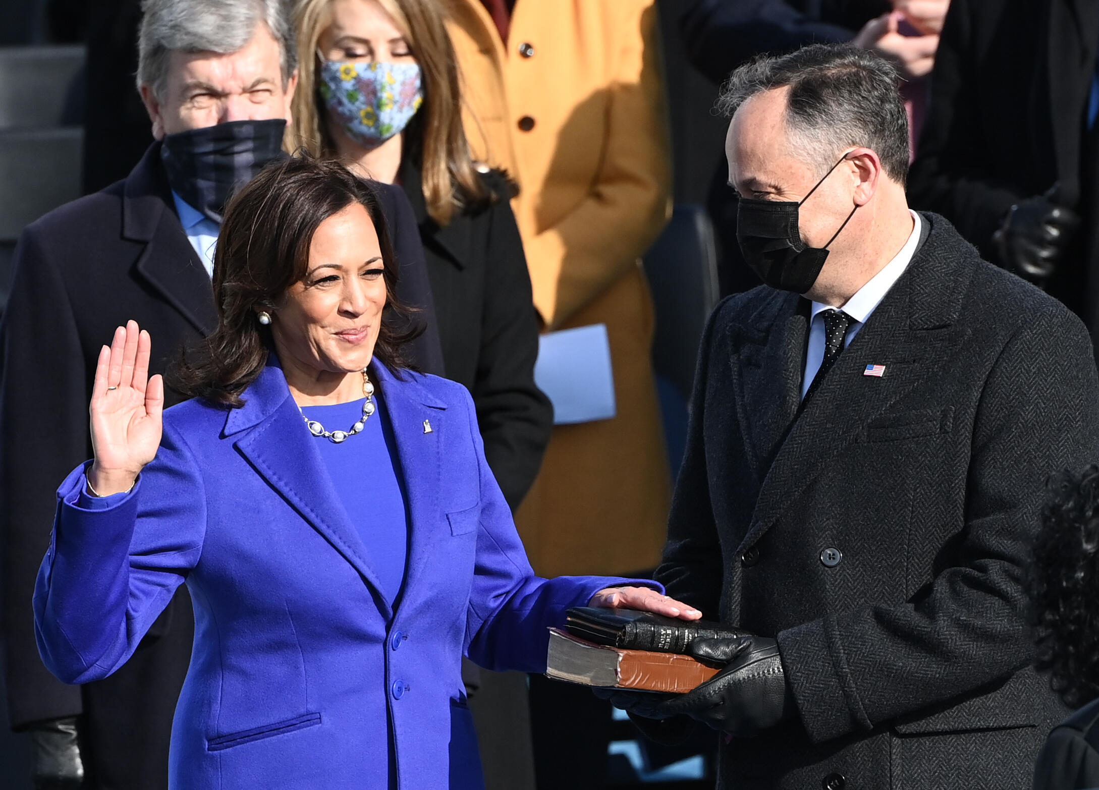 The purple of Kamala Harris during her swearing-in as Vice President of the United States symbolizes the two-party system mixing blue for Democrats and red for Republicans.