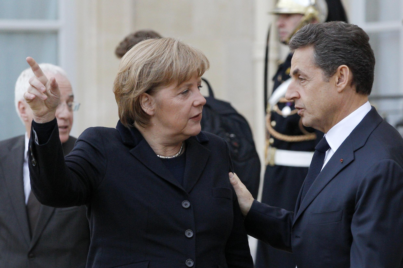 Президент Николя Саркози и канцлер Ангела Меркель в Париже 5 декабря 2011