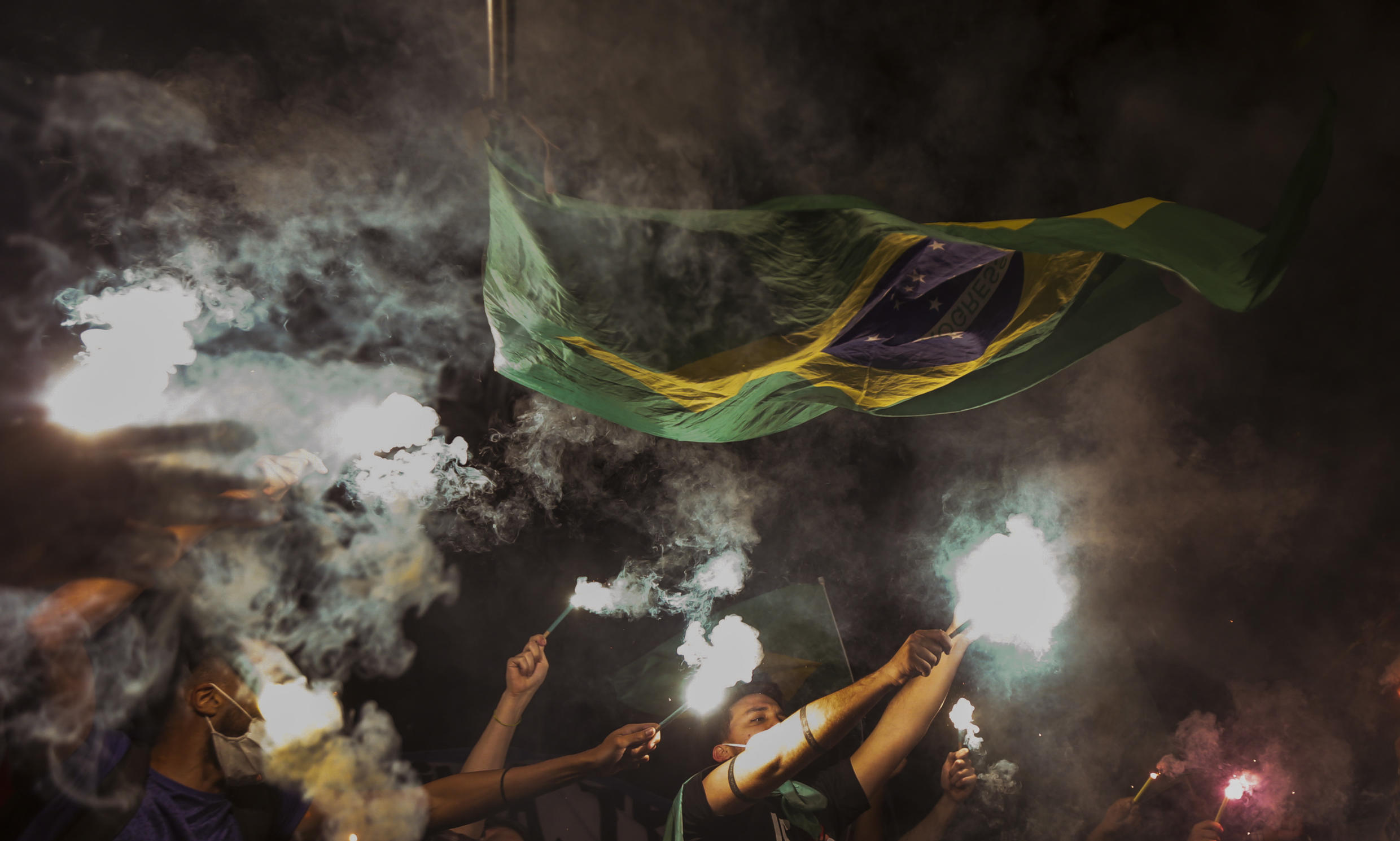 Opposition parties and other groups protest against Brazilian President Jair Bolsonaro's handling of the Covid-19 pandemic in Sao Paulo on June 19, 2021