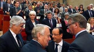 resident Francois Hollande (2ndR) speaks with Prime Minister Jean-Marc Ayrault (2ndL), Ecology and Energy Minister Philippe Martin (L) at the environmental conference