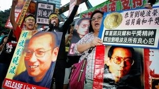 Protesters demonstrate outside the Chinese Foreign Ministry in Hong Kong