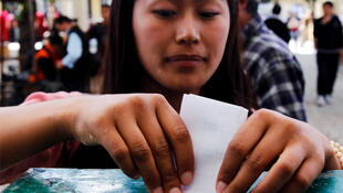 A Tibetan woman in the northern Indian town of McLeod Ganj casts her vote