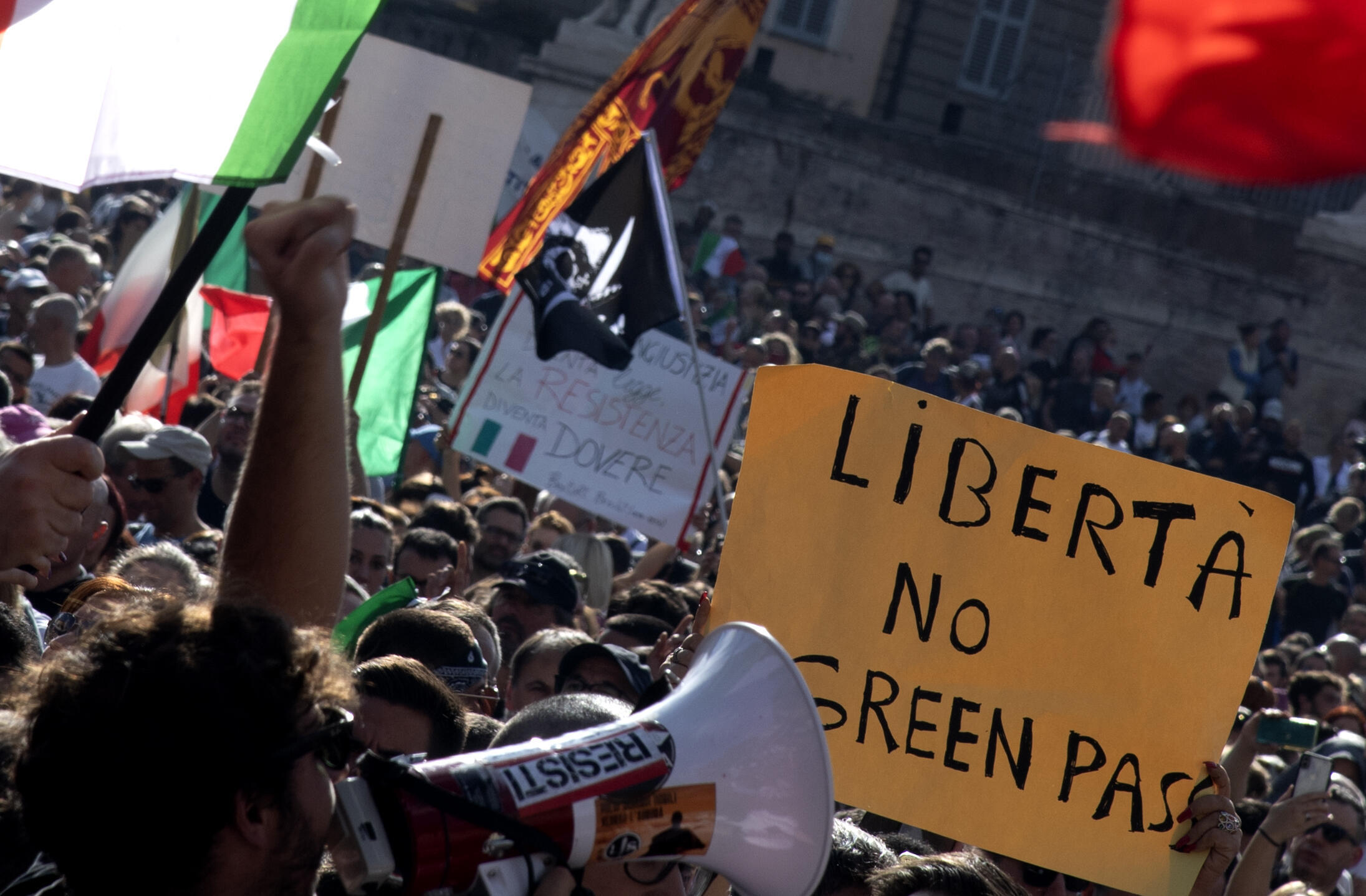 """Protesters in Italy's capital Rome demonstrated  on October 9, 2021, against the mandatory """"green pass"""" implemented to limit the spread of Covid-19"""