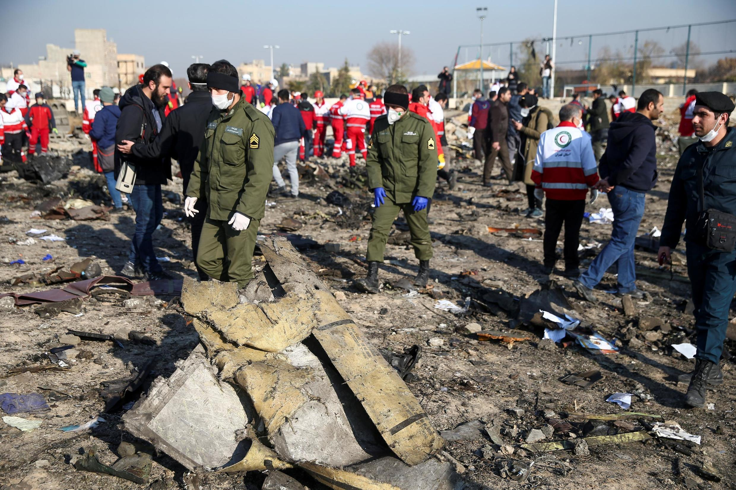 Security officers and Red Crescent workers are seen at the site where the Ukraine International Airlines plane crashed after take-off from Iran's Imam Khomeini airport, on the outskirts of Tehran, Iran January 8, 2020.