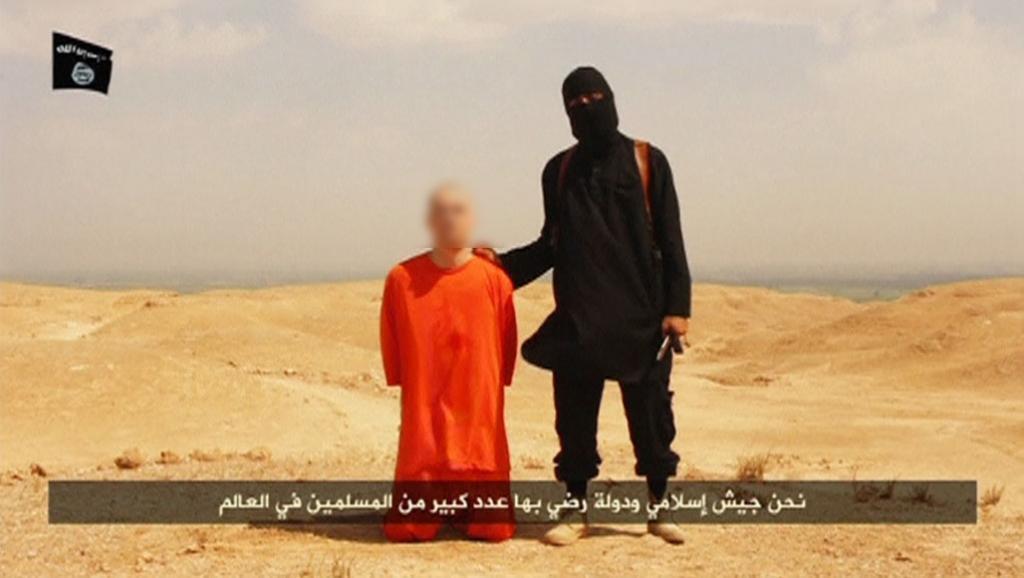 Фрагмент видеозаписи казни американского журналиста Джеймса Фоули