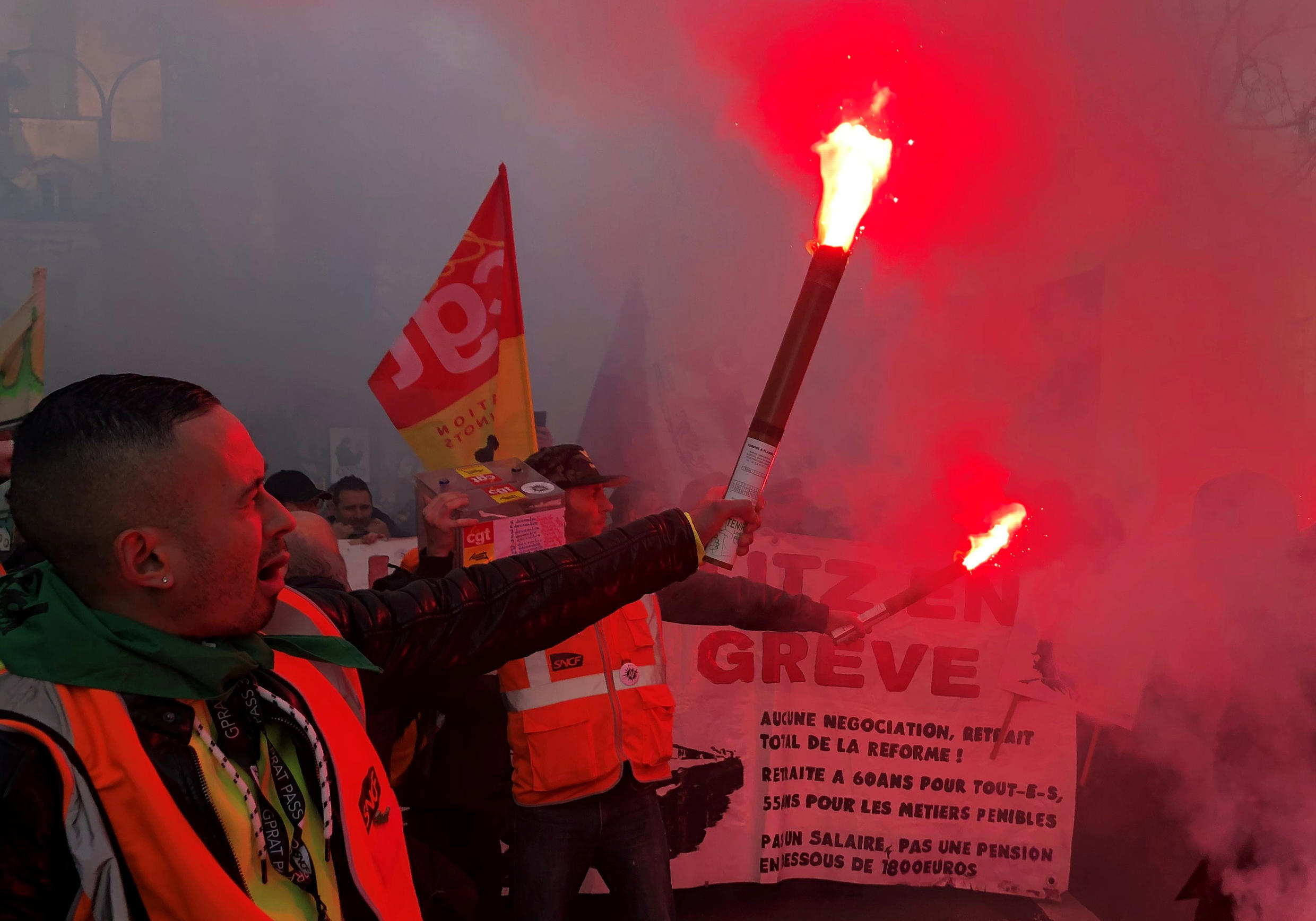 Striking French SNCF railway workers attend a demonstration against the government's pensions reform plans,17 December 2019.