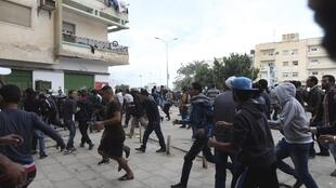 Benghazi residents flee fighting between the army and Islamists in the Ansar al-Sharia militia last year