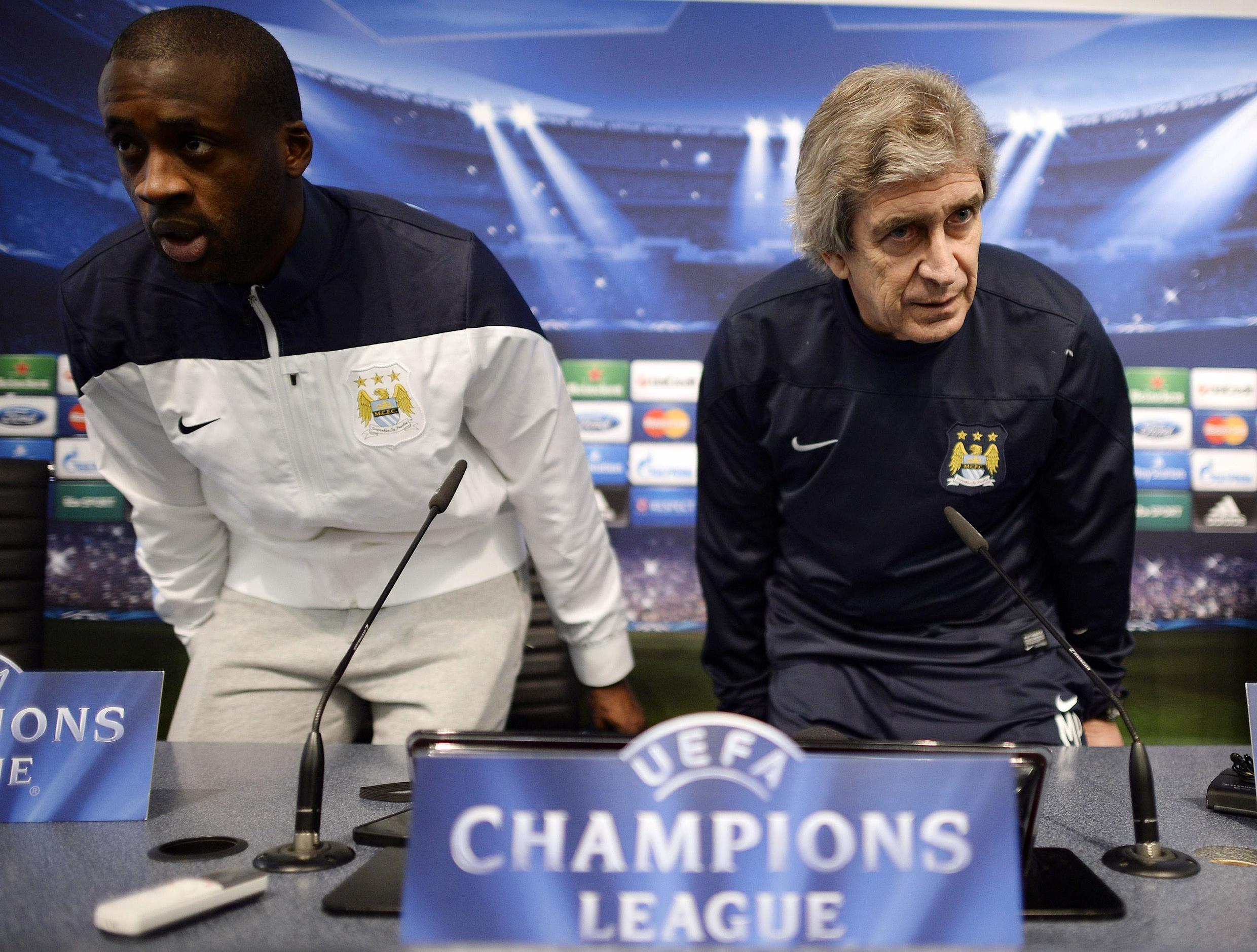 City boss Manuel Pellegrini (right) had tried to quell talk of his team romping to the English Premier League title.