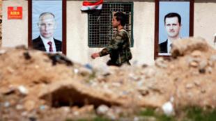 Một cảnh ở đông Ghouta : Ảnh tổng thống Nga Putin (T) và tổng thống Syria Bachar al Assad (P) trên tường. Ảnh chụp 28/02/2018.