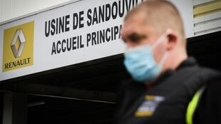 Workers returned to the Renault factory in Sandouville after it was closed down for not abiding to health and safety protocols aimed at preventing the spread of the coronavirus.