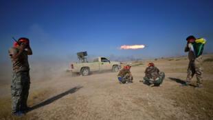 Des combattants d'une milice chiite aux abords de Tal Afar, le 22 août 2017.
