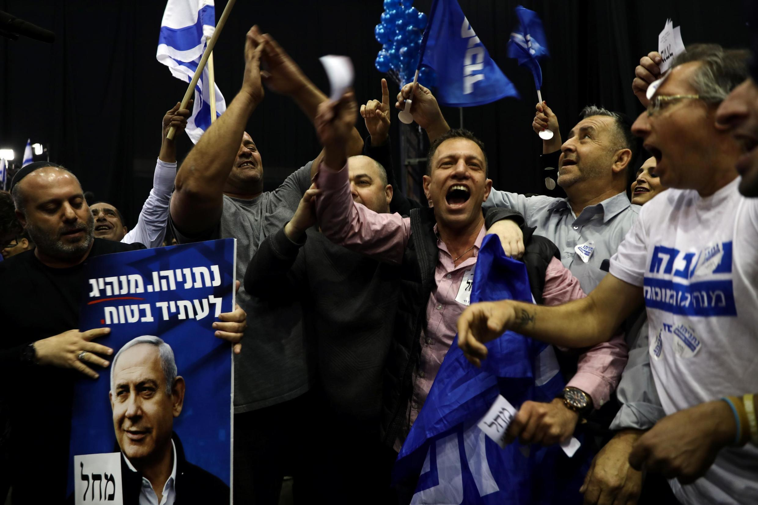Supporters of Benjamin Netanyahu at Likud party headquarters, after exit polls were announced for Israel's elections, Tel Aviv, 2 March 2020.
