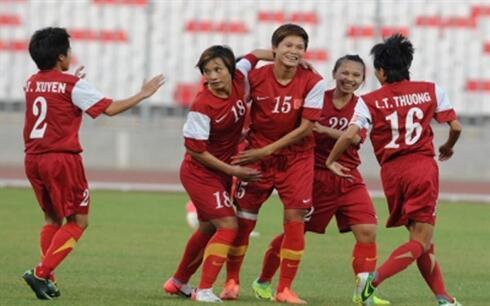 Đội tuyển bóng đá nữ Việt Nam vui mừng trước thắng lợi tại vòng loại Asian Cup nữ 2013.