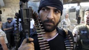 Un combattant de l'Armée syrienne libre à Al-Sakhour, près d'Alep, le vendredi 21 juin.