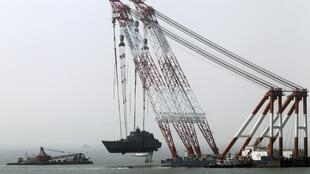 The Chenan is hauled out of the water by a giant crane, Baengnyeongdo island, 24 April