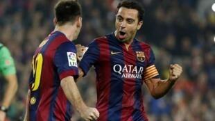 Lionel Messi da Xavi Hernandez yayin murnar jefa kwallo a ragar Sevilla. 22/11/2014.