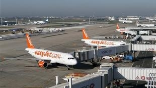 EasyJet aircrafts sitting on the tarmac at Orly airport.