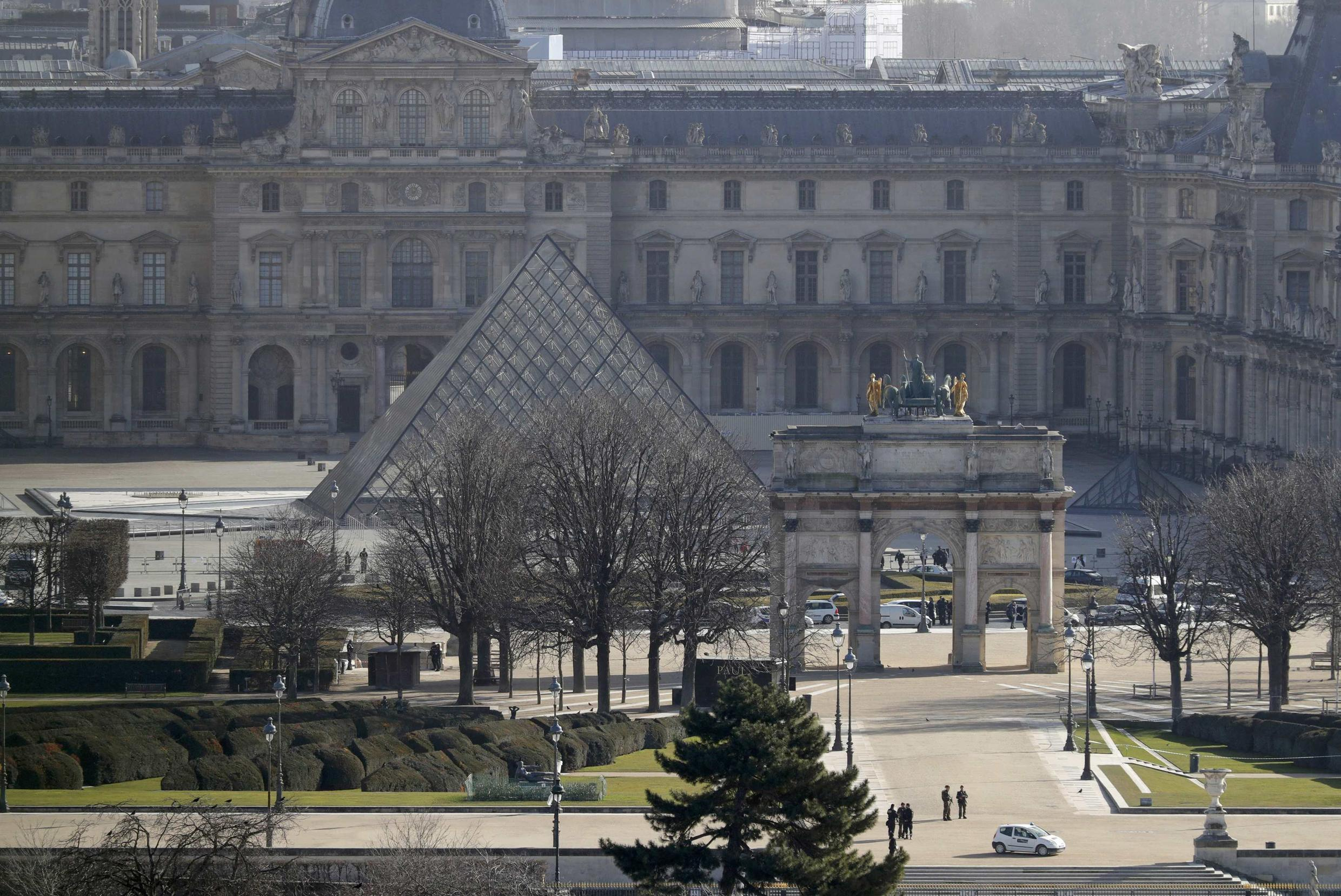 the Carrousel du Louvre and the Louvre Pyramid as French police secure the site in Paris, France, February 3, 2017 after a French soldier shot and wounded a man armed with a machete and carrying two bags on his back as he tried to enter the Louvre museum.