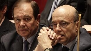Alain Juppe (right) attends a questions to the government session at the National Assembly, 1 March 2011