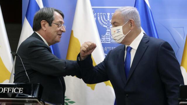 """打过疫苗可入境:""""优等生""""以色列和塞浦路斯互推""""新冠疫苗护照""""(photo:RFI)"""