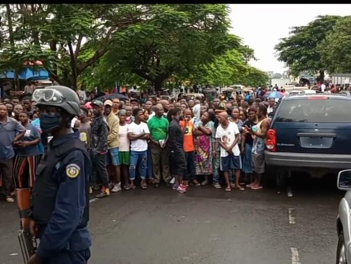 Liberians on the scene where the two LRA employees were discovered dead