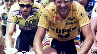 Laurent Fignon (R) smiles as he rides in front of Greg LeMond in the 1989 Tour de France.