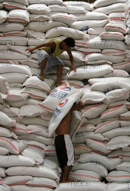 Moving rice in a warehouse in Manila, Philippines