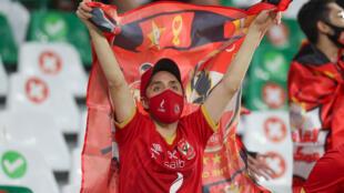An Al-Ahly fan cheers on their side at their first FIFA Club World Cup clash against Qatar's Al-Duhail