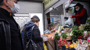 People buy vegetables at a street market on the outskirts of Moscow on April 11, 2020.