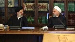 حسن روحانی رئیس جمهوری و ابراهیم رئیسی رئیس قوۀ قضائیه جمهوری اسلامی ایران.