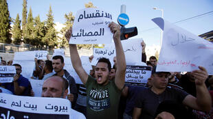 Manifestation de Palestiniens à Bethléem, ce mercredi 20 juin 2018, demandant au président Abbas de lever les sanctions contre la bande de Gaza.