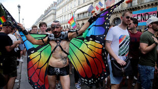 A participant attends the annual Gay Pride parade in Paris