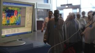 Infrared scanner to scan the temperatures of passengers at Cairo airport, Egypt, 13 october 2014.