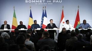 France's President Emmanuel Macron delivers a news conference as part of the G5 summit in Pau flanked by his west African counterparts, France January 13, 2020