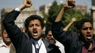 Demonstrators shout slogans during anti-government protest in Sanaa